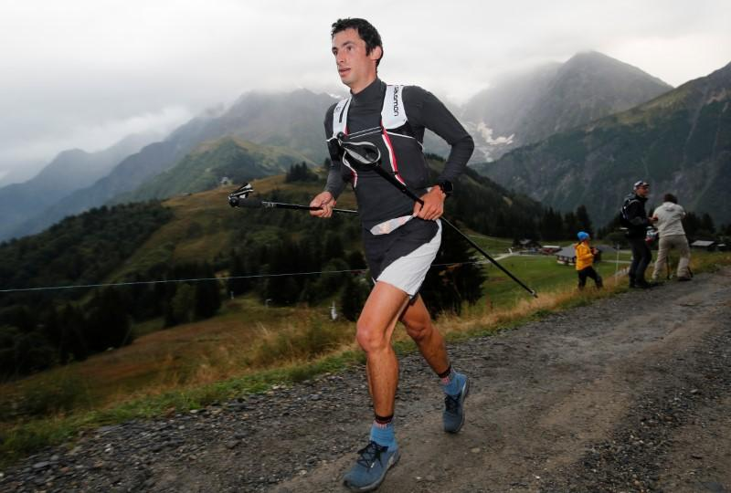 Ultra trail runner Jornet beats base jumper in odd contest