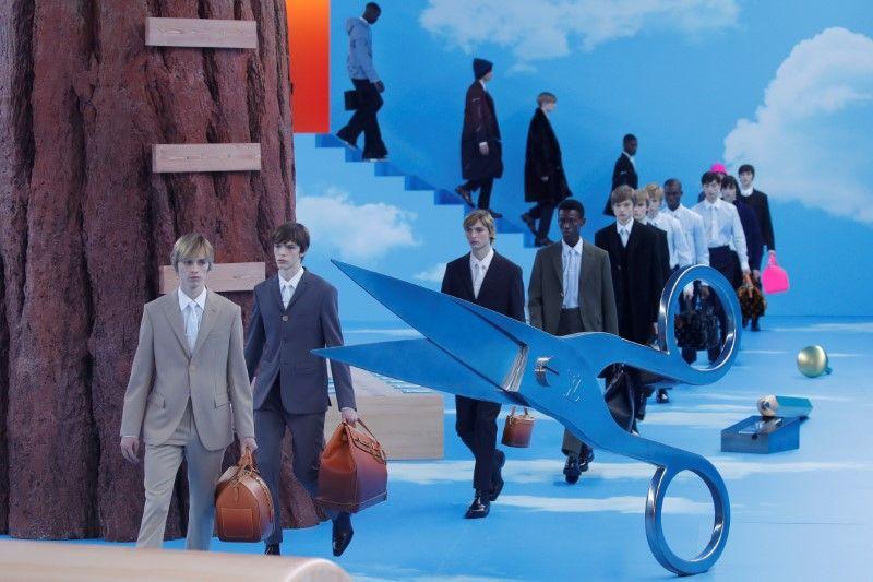 In Vuitton's catwalk 'heaven', slick suits trump streetwear