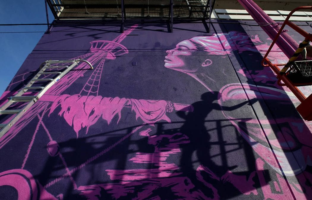 Artists' mural transforms Fremont Street wall
