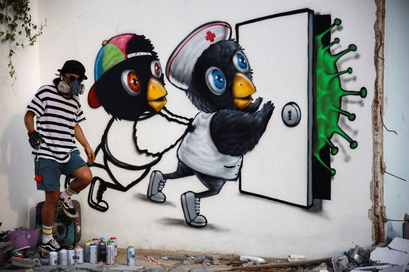 Thai artist 'restless hands' takes coronavirus battle to the streets