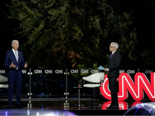Watch: Joe Biden Violates Social Distancing When He Think He's Off Camera