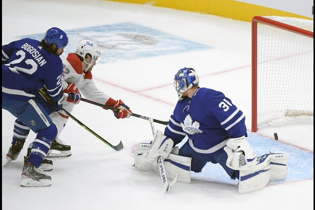 Leafs open with OT win over Canadiens