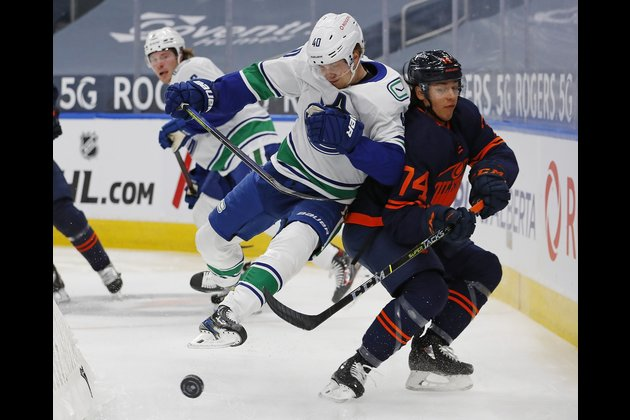 Canucks pull away from Oilers in third period