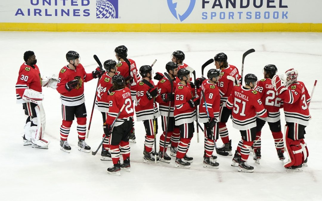 Pius Suter's hat trick helps Blackhawks down Red Wings