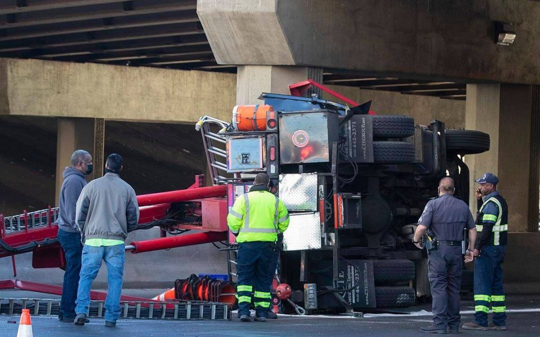 Semi overturns in central Las Vegas, impacting access to I-15