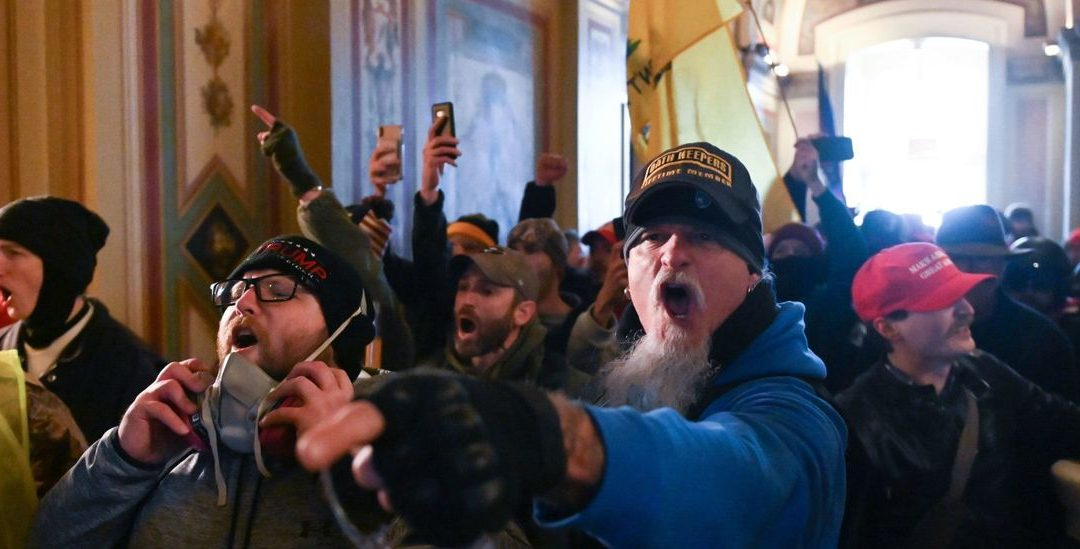 Two Off-Duty Cops Charged In Capitol Riots; One Allegedly Bragged He 'Attacked The Government'