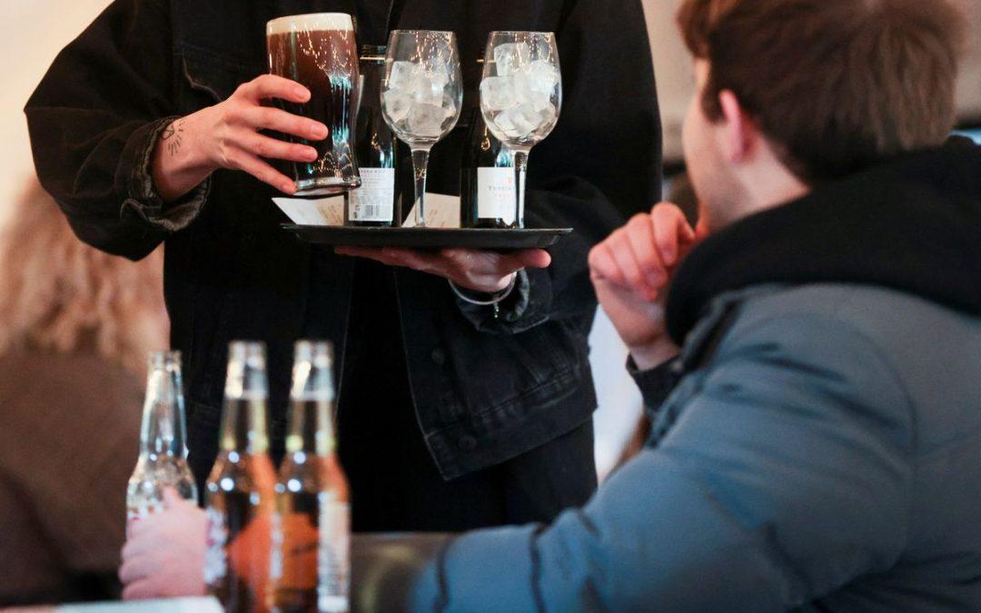 Pack your thermals: English drinkers brave snow to lift a pint in pub gardens