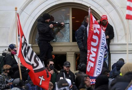 tagreuters.com2021binary_LYNXMPEH0C1AH-VIEWIMAGE Exclusive: Facebook tracking a rise in violent rhetoric tied to U.S. presidential inauguration Business [your]NEWS