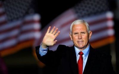 Six days to U.S. election, Pence campaigns in coronavirus hotspot Wisconsin as cases surge