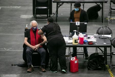 U.S. tops 10 million COVID vaccinations as California expands eligibility for shots