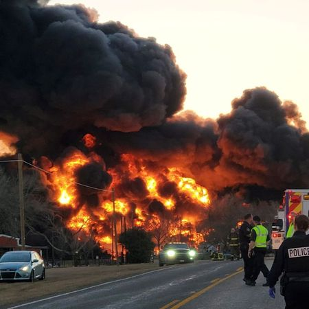 tagreuters.com2021binary_LYNXMPEH1M1C0-VIEWIMAGE BNSF fuel train cars on fire after colliding with truck in Texas U.S. [your]NEWS