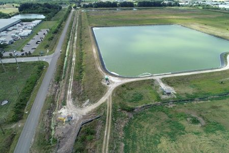 tagreuters.com2021binary_LYNXMPEH340PZ-VIEWIMAGE Crews race to drain Florida wastewater reservoir on brink of collapse Environment Top Stories U.S. [your]NEWS