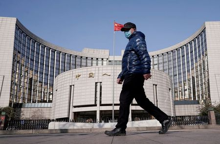 China March new bank loans rise but broad credit growth eases
