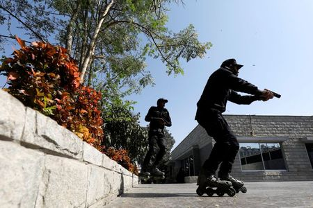 tagreuters.com2021binary_LYNXMPEH1M00V-VIEWIMAGE Pakistan police pop their rollerblades on to catch Karachi's criminals World [your]NEWS