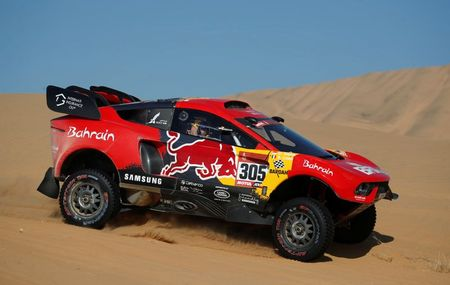 Rallying-Peterhansel takes Dakar lead from team mate Sainz