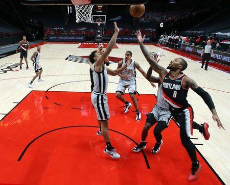 tagreuters.com2021binary_LYNXMPEH0I09J-VIEWIMAGE NBA: Bench leads way as Spurs handle Trail Blazers Basketball Sports [your]NEWS