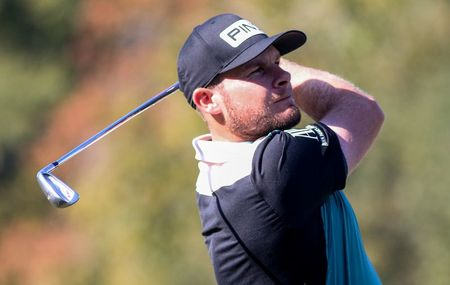 Hatton takes five-shot lead in Abu Dhabi as fading light stops play
