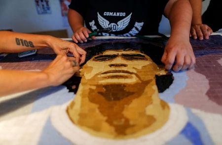 Pain to tiled art: Argentines honor soccer star Maradona with mosaics