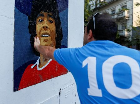 tagreuters.com2021binary_LYNXMPEH1P002-VIEWIMAGE Pain to tiled art: Argentines honor soccer star Maradona with mosaics Soccer Sports [your]NEWS