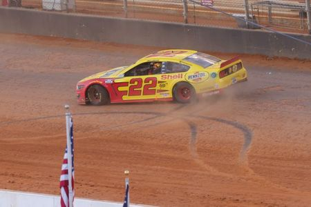 Joey Logano takes late lead, wins dirt race at Bristol