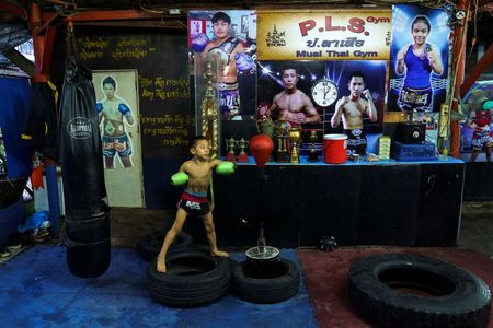 Punching out of poverty: Despite risks, 9-year-old Thai fighter eager to return to ring