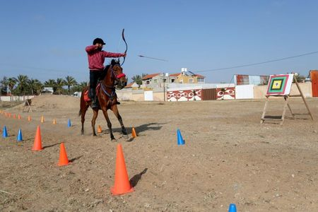 tagreuters.com2021binary_LYNXMPEH4309P-VIEWIMAGE First team of mounted archers takes aim in Gaza World [your]NEWS