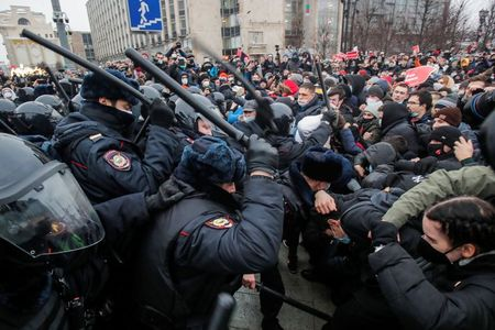 Police crack down on Russian protests against jailing of Kremlin foe Navalny