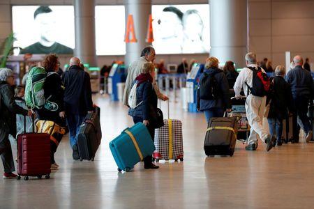 tagreuters.com2021binary_LYNXMPEH0N0CM-VIEWIMAGE Israel bans international flights to curb coronavirus spread World [your]NEWS