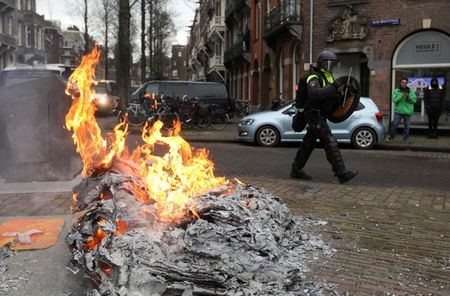 tagreuters.com2021binary_LYNXMPEH0N0CV-VIEWIMAGE Dutch police detain 240 nationwide as anti-lockdown protests turn violent Top Stories World [your]NEWS