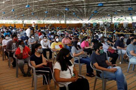 tagreuters.com2021binary_LYNXMPEH430DB-VIEWIMAGE India halts cricket league as coronavirus cases cross 20 million World [your]NEWS