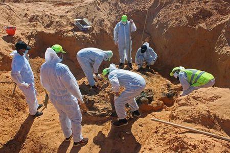 Libyan investigators find more mass graves in recaptured city