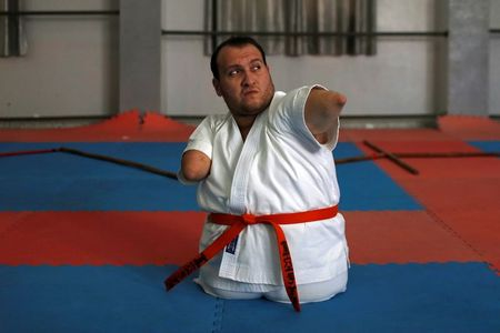 Gaza man with disabilities conquers karate