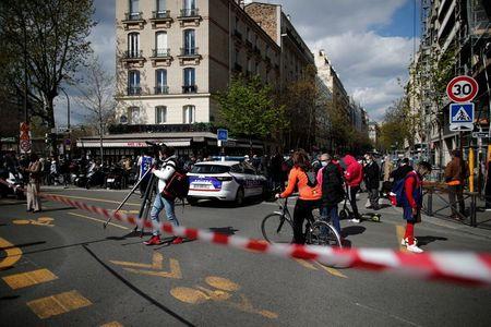 Gunman shoots man dead, injures woman in front of Paris hospital