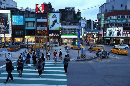 Taiwanese cities tighten restrictions after COVID-19 cases rise