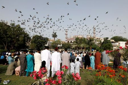 Muslims mark Eid with masks and prayers amid COVID and conflict